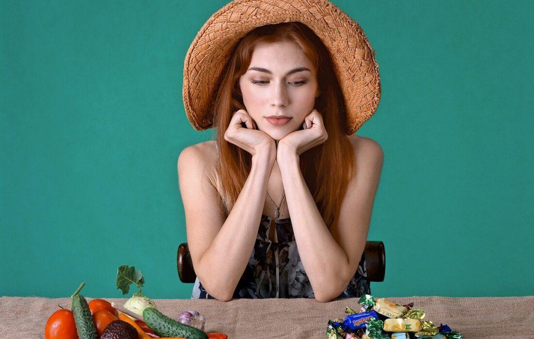 выбор между конфетами и овощами